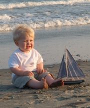 Baby boy and sailboat
