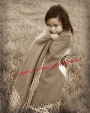 Little girl in blanket